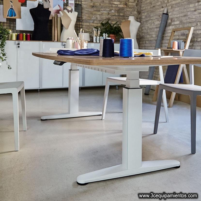 la regulacion en altura de la mesa de trabajo como elemento ergonomico
